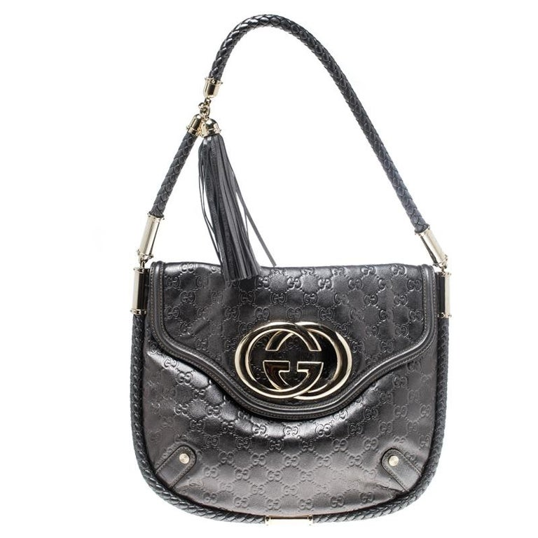 854c4fcb430 Gucci Metallic Grey Leather Medium Britt Tassel Hobo For Sale at 1stdibs