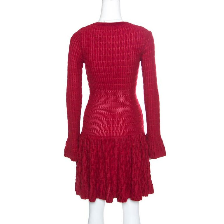 Dress it up or dress it down for both day and night wear, this Alaia skater dress is effortlessly stylish for parties and events. Made from a wool blend, this red creation features long sleeves with fluted cuffs and a flattering silhouette with a