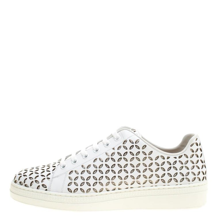 Fashioned to take your style a notch higher, these sneakers from Alaia are absolutely worth the dream and the splurge! They've been crafted from leather and styled with laces on the vamps and laser cuts all over.  Includes: Original Box  The Luxury