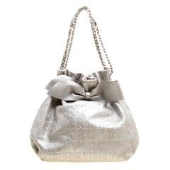 Carolina Herrera Silver Monogram Embossed Leather Bow Bucket Shoulder Bag
