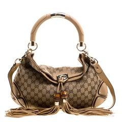 Gucci Beige Monogram Canvas Medium Indy Top Handle Bag