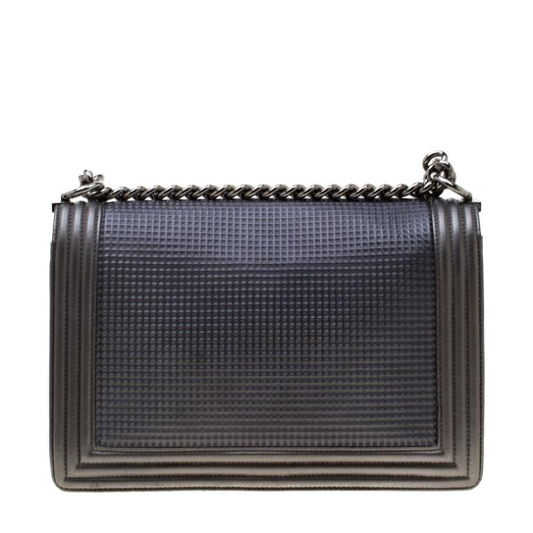 The Chanel Cube Boy bag was introduced in the brand's Cruise 2014 collection and it comes as an interesting update of the Boy flap bag. The bag has cube embossings which also look like little waffles and the CC lock on the flap is decorated in