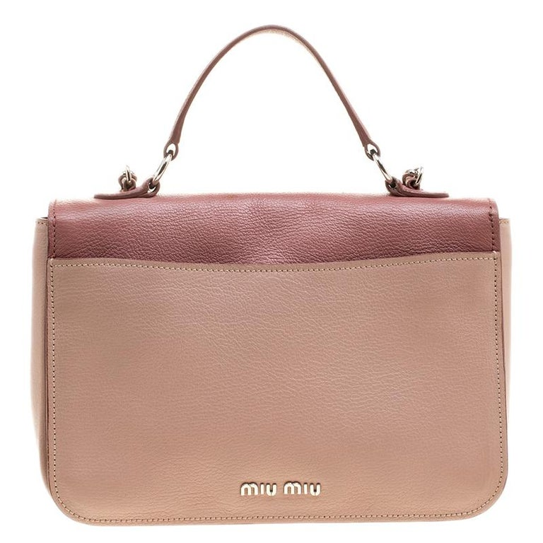 A beautiful handbag from the house of Miu Miu is all yours to flaunt this  season 090a18373efb9