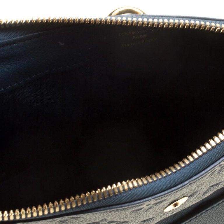 d3a497b40574 Women s Louis Vuitton Orage Monogram Empreinte Leather Petillante Clutch  For Sale