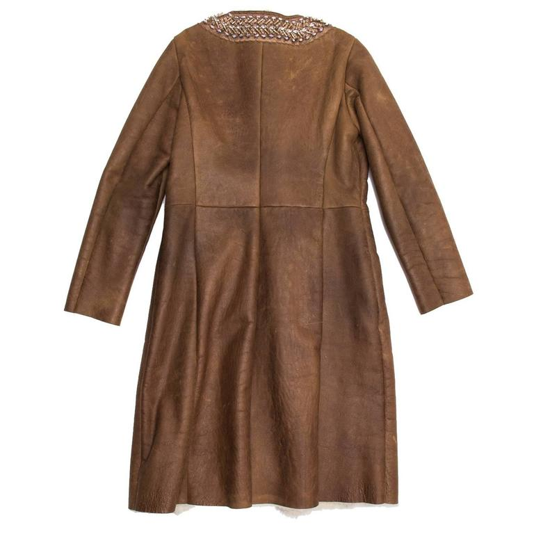 Toffee brown naturally distressed leather coat with shearling lining and mink fur trim down center front, single welt pockets at front. Hand stitched satin trim around neckline with beading and crystals.  Size  46 Italian sizing Condition