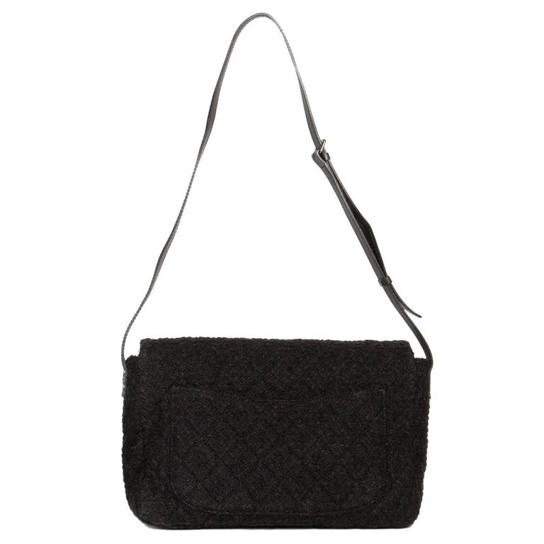 "Large classic quilted Chanel style bag with a fun twist given by the black boucle wool. The bag has a black leather cross-body adjustable strap and fastens with a silver buckle. Made in France.  Size  H 11"" L 18"" W 5"" STRAP 55.5"""
