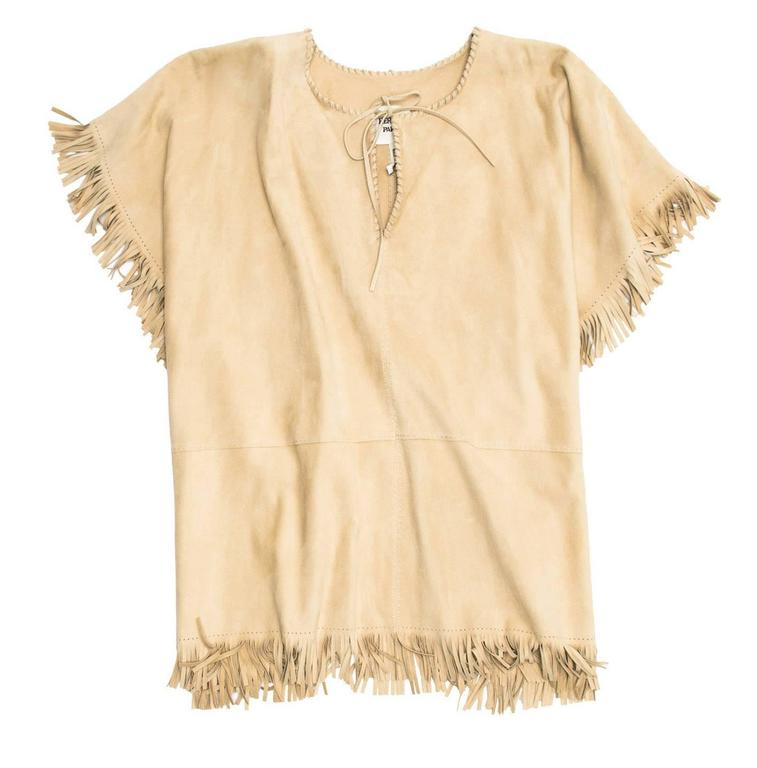 Natural color suede fringe poncho with whip-stitch V-neck tie collar and hidden ties at waist area.  Size: One size  Condition  Excellent: never worn