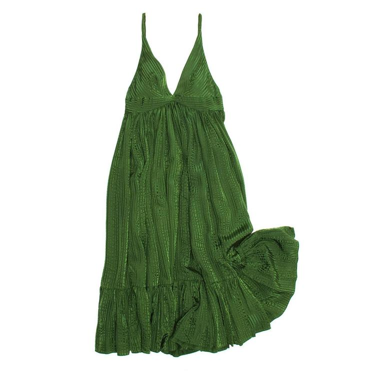 Green silk jacquard stripe hippie chic dress with thin shoulder straps and empire line. The body panel is gathered below the empire line around the body creating the volume on the skirt. The dress fit is wide, mid calf length and with a gathered