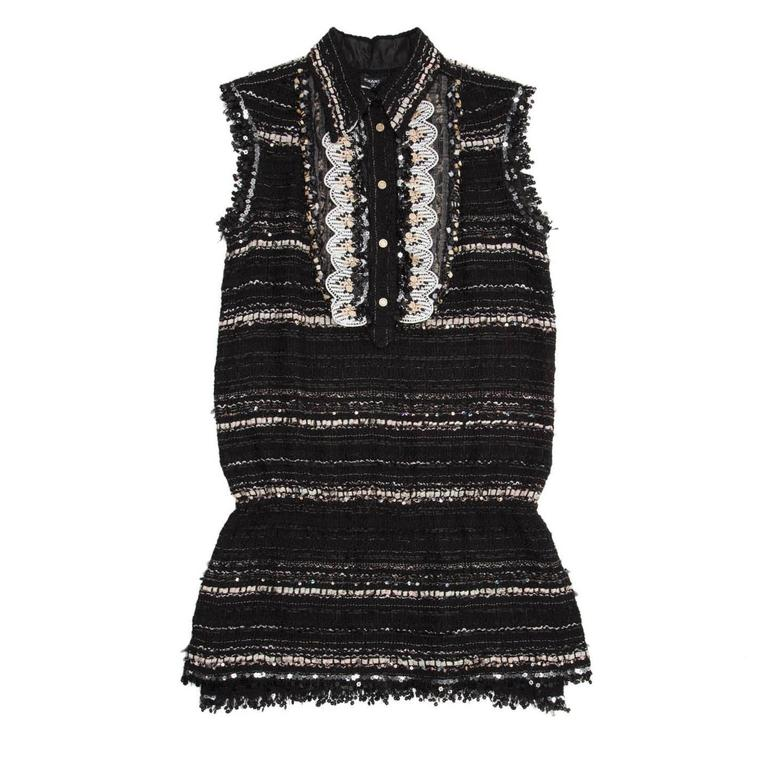 Black, grey and pink cotton blend tweed tunic with spread collar and shirt front that fastens with gold metal Chanel logo buttons. A bib detail is enriched by a silk panel, trims, floral lace and black and silver sequins. The hem and armholes are