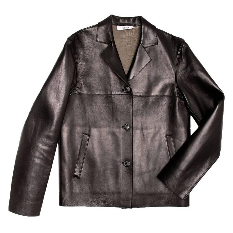 Black leather cropped jacket with soft warm olive leather interior. Single breasted closure with small notched lapel. Front and back yoke. Front side pockets.  Size  40 Italian sizing  Condition  Excellent: Never worn with subtle scratches due