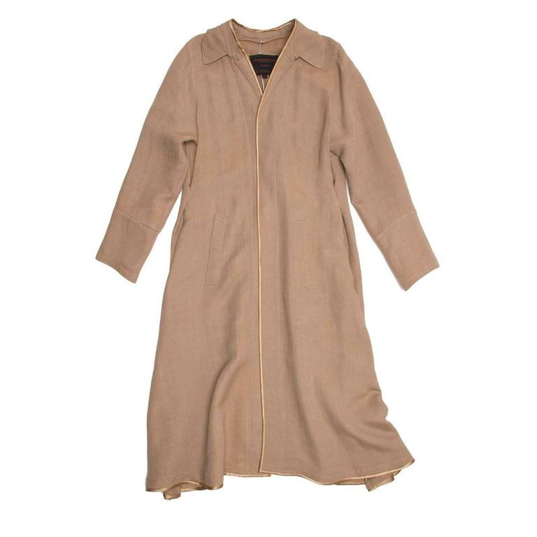 Bronze and beige linen/rayon/cotton blend woven duster style coat with bronze satin binding to cover and embellish front, neckline and hem edges. This piece is characterized by many beautiful and unique details: the collar is folded, stitched down