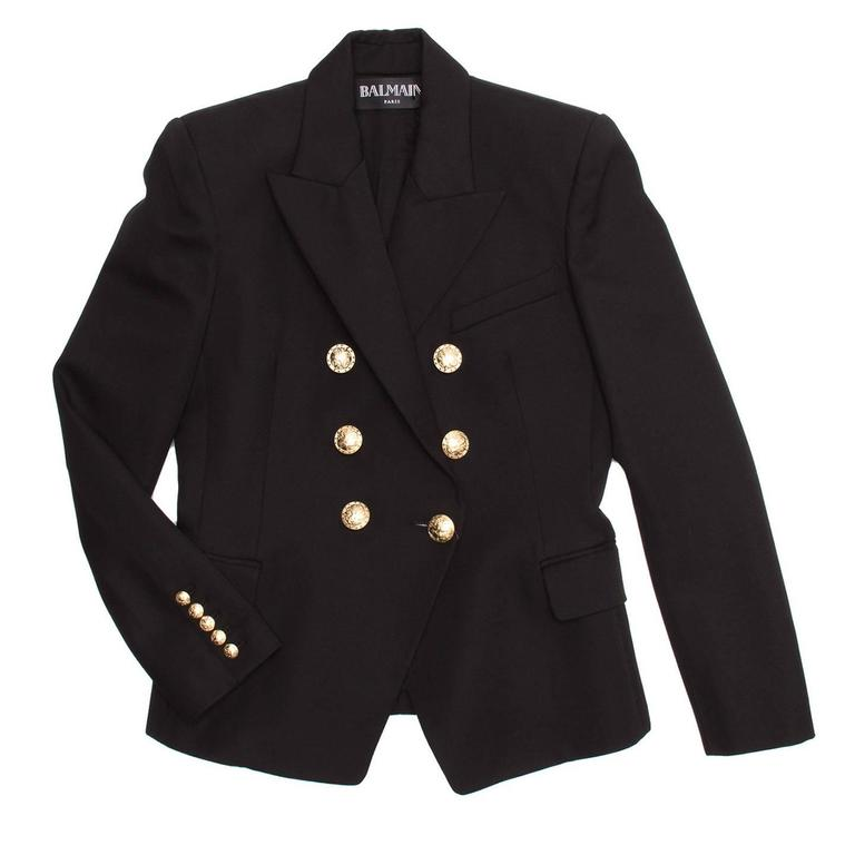 Double breasted black tailored wool coat with gold ornate buttons. Peaked lapels with handkerchief pocket at front. 5 rows of buttons at back cuff and flap pockets at the sides. New with tags.
