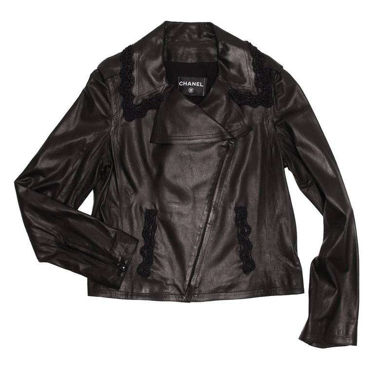Soft black lambskin leather motorcycle style with crocheted trim on front pockets and around the collar for a feminine touch. The front black zip is elegantly concealed under a tiny flap as well as the zips on the cuffs.  Size  44 French