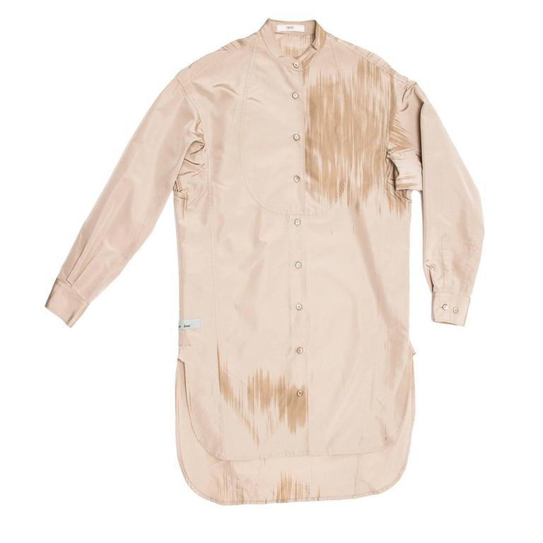 Taupe silk/polyester tunic style comfortable shirtdress with Nehru collar, bib front and paint brush detailing at front and back. The hem is round with detailed vents at side seams and the back is longer than the front. Made for Art Basel.