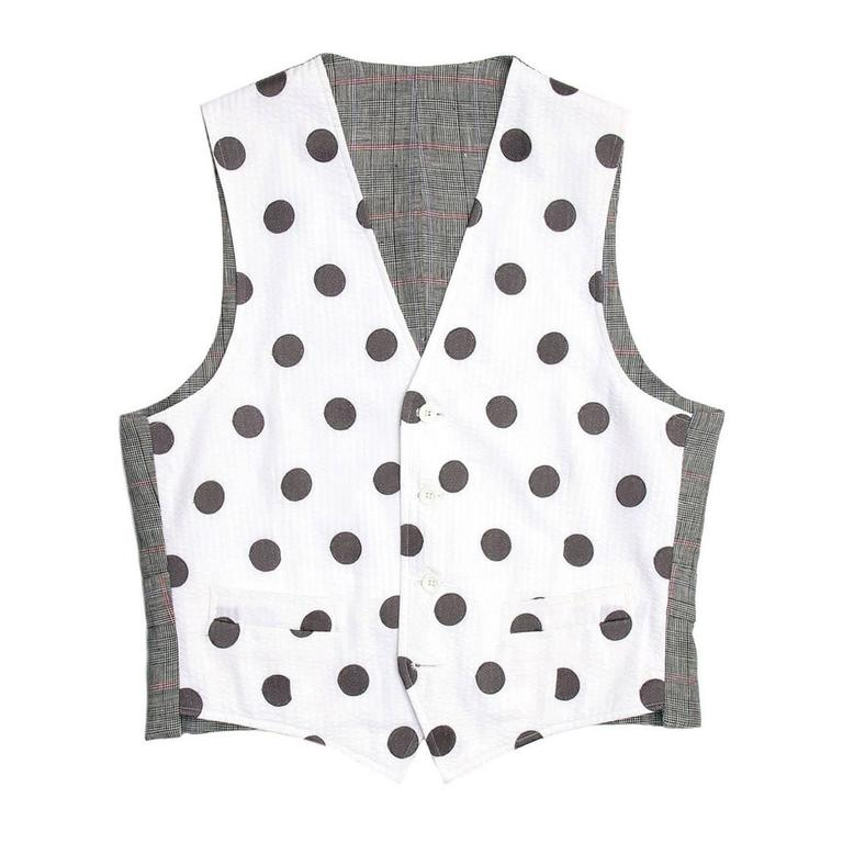 Seersucker vest with white cotton and wide grey polka dots front. The back of the vest is grey, white, blue and red tartan with a thin buckle back that fastens with two white rubber buttons to match the ones at front.