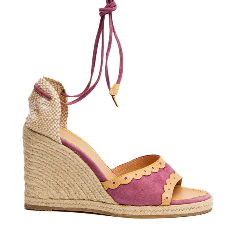 "Purple suede wedge sandals with tan leather applique, a canvas heel and a lace up ankle long straps. The Wedge is made of jute rope in a beautiful espadrille-inspired style. Made in Spain. Wedges heel: front 3/4"" back 4.5"".  Size  40 Italian"
