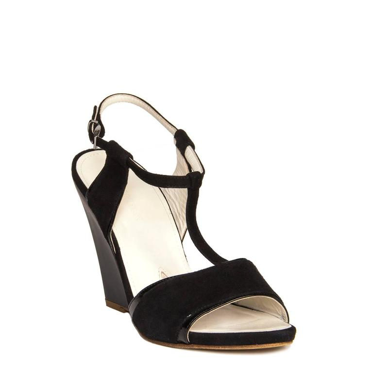 Black suede sandals with patent leather inserts and matte wedges. T-bar style with open front and a small silver buckle to fasten the thin ankle strap. Made in Italy. Heel 4