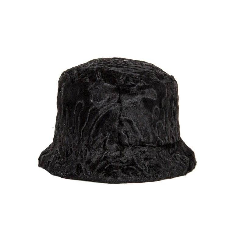 Prada black broadtail lamb fur hat with small brim and silk lining. Origin: Afghanistan.  Size  M Universal sizing  Condition  Excellent: never worn