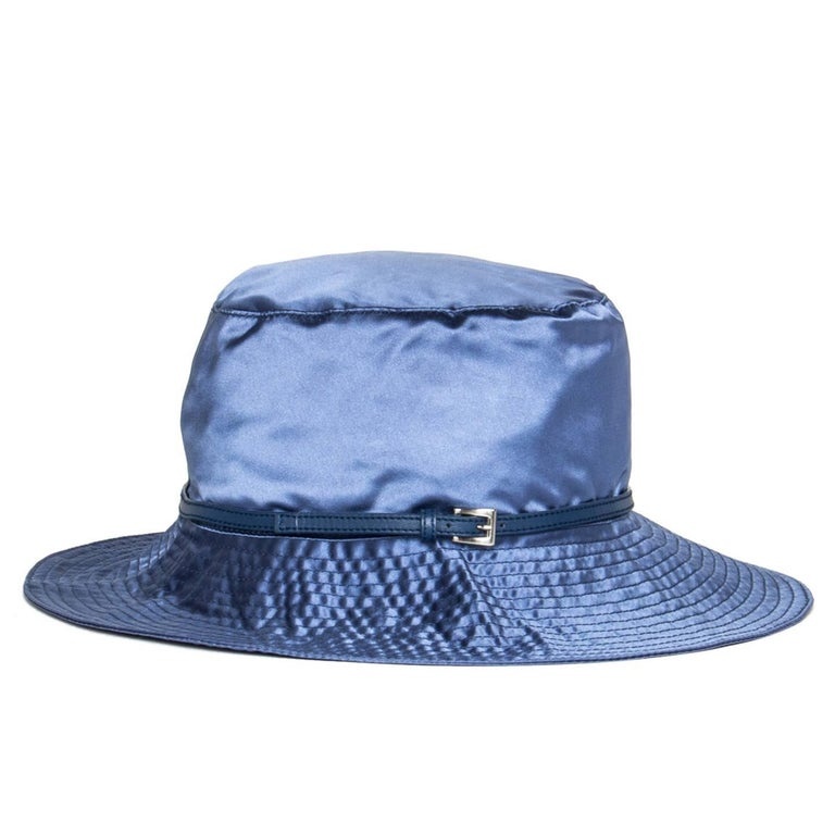 Prada royal blue silk hat with medium brim embellished by stitching details and a thin leather band that fastens with a small silver buckle.  Size  M Universal sizing  Condition  Excellent: worn a few times
