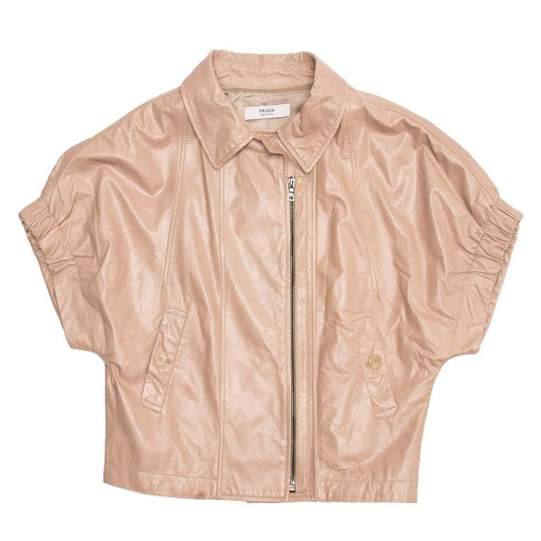 Tan cropped bolero collared short-sleeve soft leather jacket with side front zipper opening.