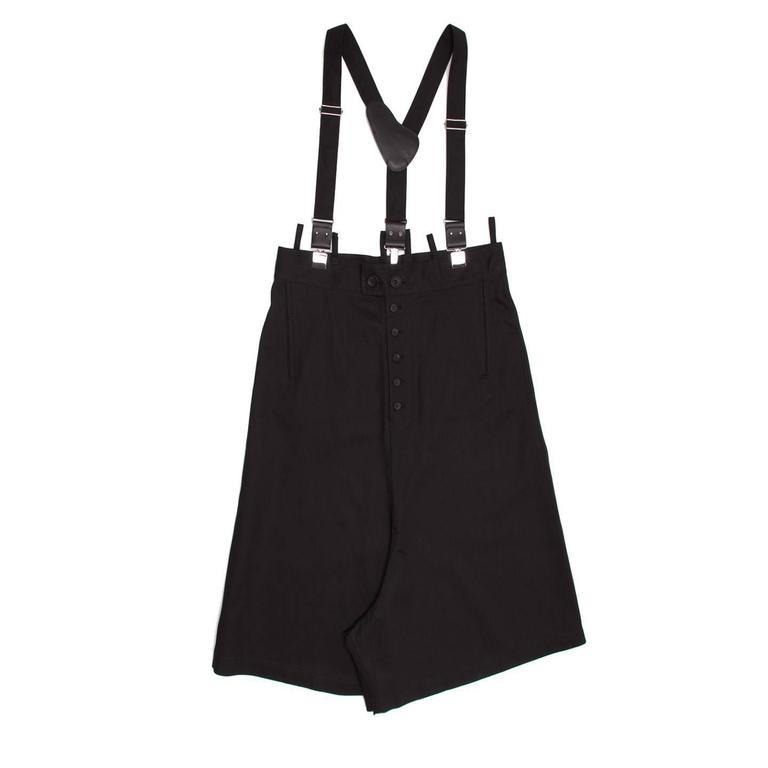 Black denim drop crotch culottes with high waist and visible buttons on front waist line and fly. Small loops decorate the belt at front and back and a self-fabric and leather suspender enriches this style. Made in Japan.  Size  2  Condition