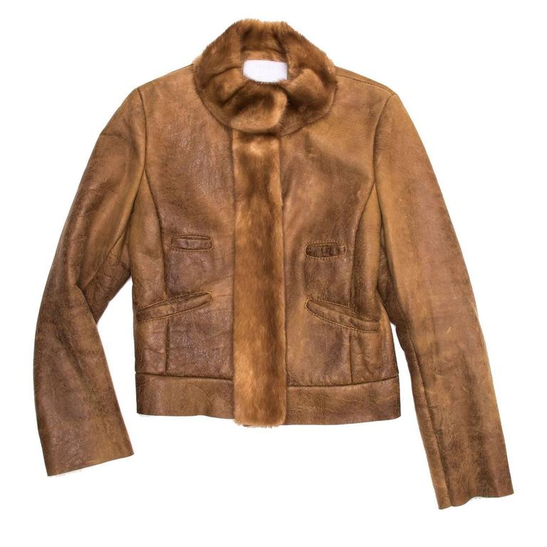 Fitted brown distressed leather shearling lined jacket with mink detailing on band collar and front jacket opening.  Size  44 Italian sizing  Condition  Excellent: worn a few times