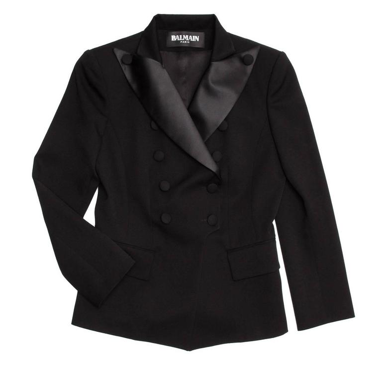 Black wool tuxedo style jacket tapered at waist for a feminine fit. Double breasted closure with wide satin lapels and wool covered buttons.  Size  44 French sizing  Condition  Excellent: worn a few times