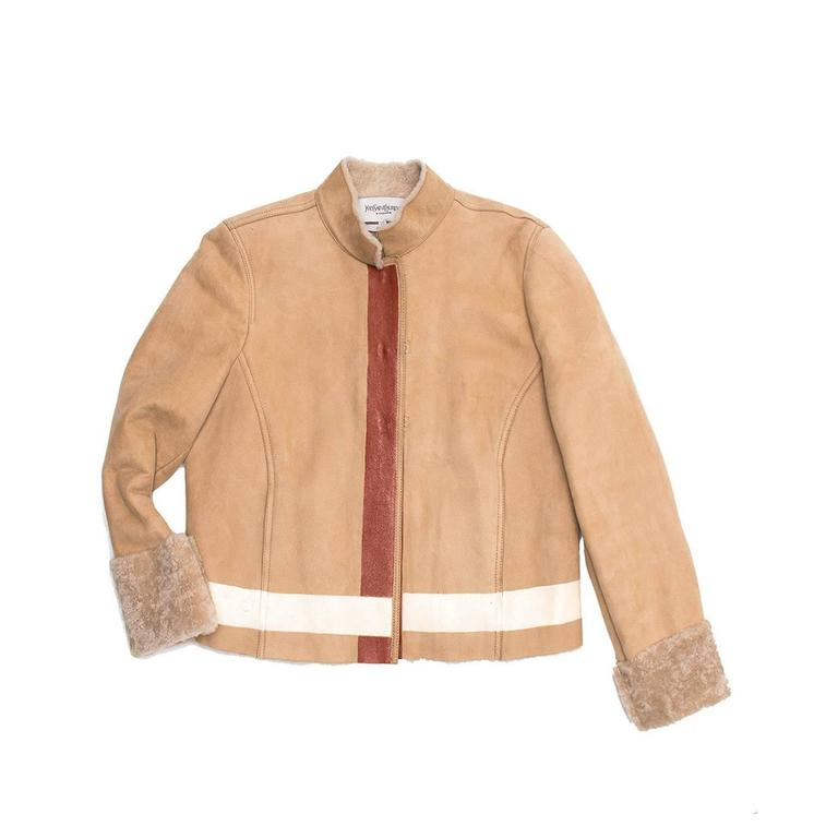 Tan suede shearling lined racer style jacket with hand painted orange/ivory striped detailing on cuff, waist and front closing. Jacket closure is with hook and eye detailing.   Size  40 French sizing  Condition  Excellent: worn a couple of times