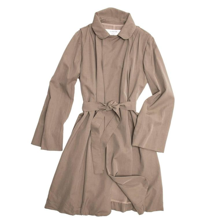 Lanvin 2007. Taupe cotton/viscose blend trench coat with round notched collar. Small pleats on the shoulders create movement and volume to the body and a sash-tie fastens at waist.  Size  40 French sizing  Condition  Excellent: never worn