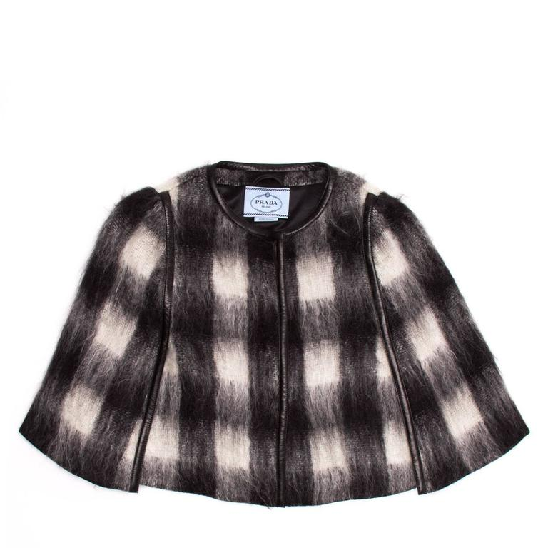 Black & white checkered plaid cropped mohair caplet with round neck and black leather piping.  Size  44 Italian sizing  Condition  Excellent: worn once