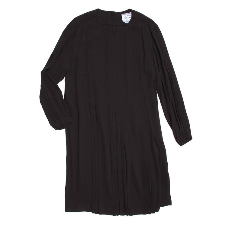 Lovely black long sleeve silk pleated baby doll dress with button down closure detailing down back.  Size  42 Italian sizing  Condition  Excellent: never worn