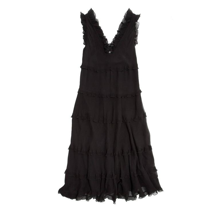 Black crinkle silk chiffon sleeveless dress with tiers and ruffles on each level, hem, around armholes and neck. The dress is ankle length, fully lined, with an A-shape line and a V-neck equally deep at front and back.  Size  44 Italian