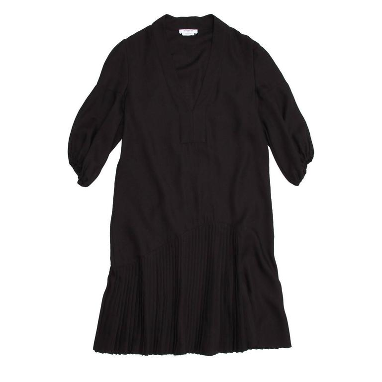 Black wool V-neck dress with short bloussant sleeves. Asymetrical seam with pleating wraps around to the back. Lovely drop waisted silhouette. Made in Italy.  Size  42 French sizing  Condition  Excellent: never worn