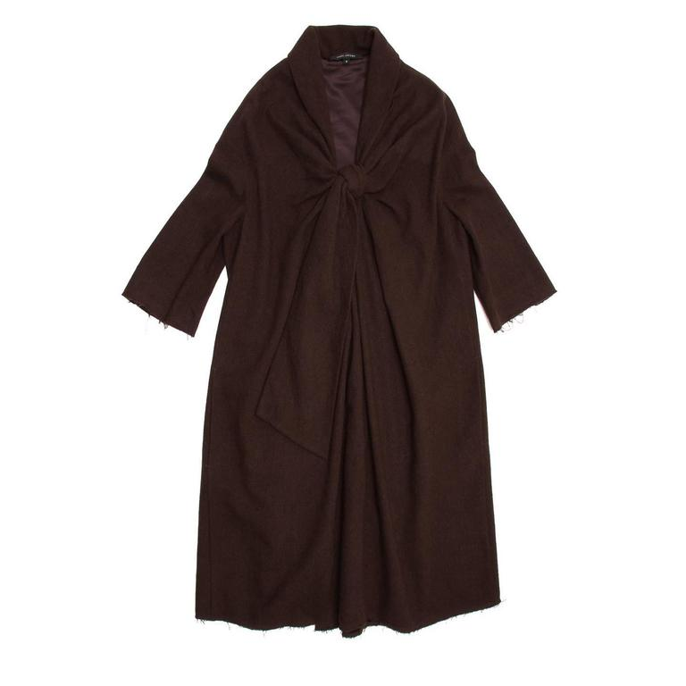 Chocolate brown boiled wool dress with a shawl collar. Oversized tie front and frayed cuffs and hem. Loose fitting with gathers at back rounded seam.  Size  8 US sizing  Condition  Excellent: never worn
