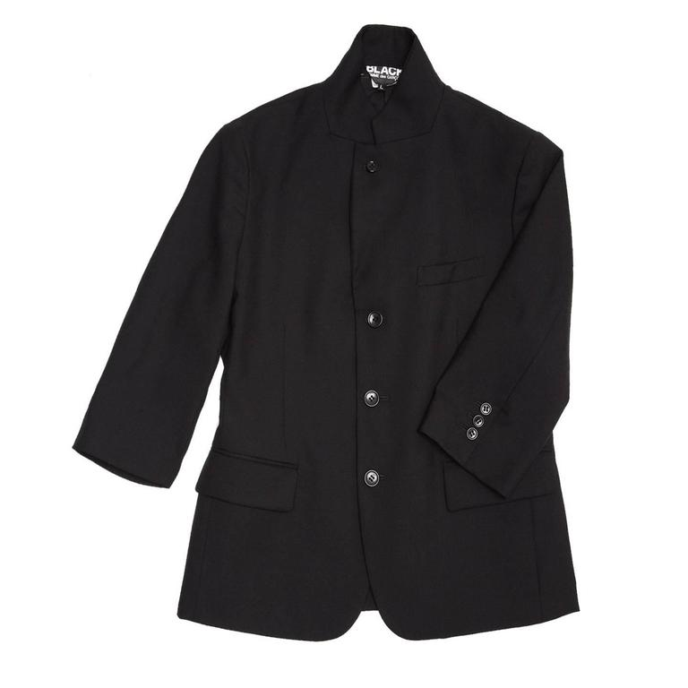 Black wool 3 buttons blazer with small lapel that can be worn standing up as well. The sleeves are 3/4 length, it has a breast pocket and 2 flap pockets at waist and a vent at center back. It is a Japanese size Large - fits as a U.S. size