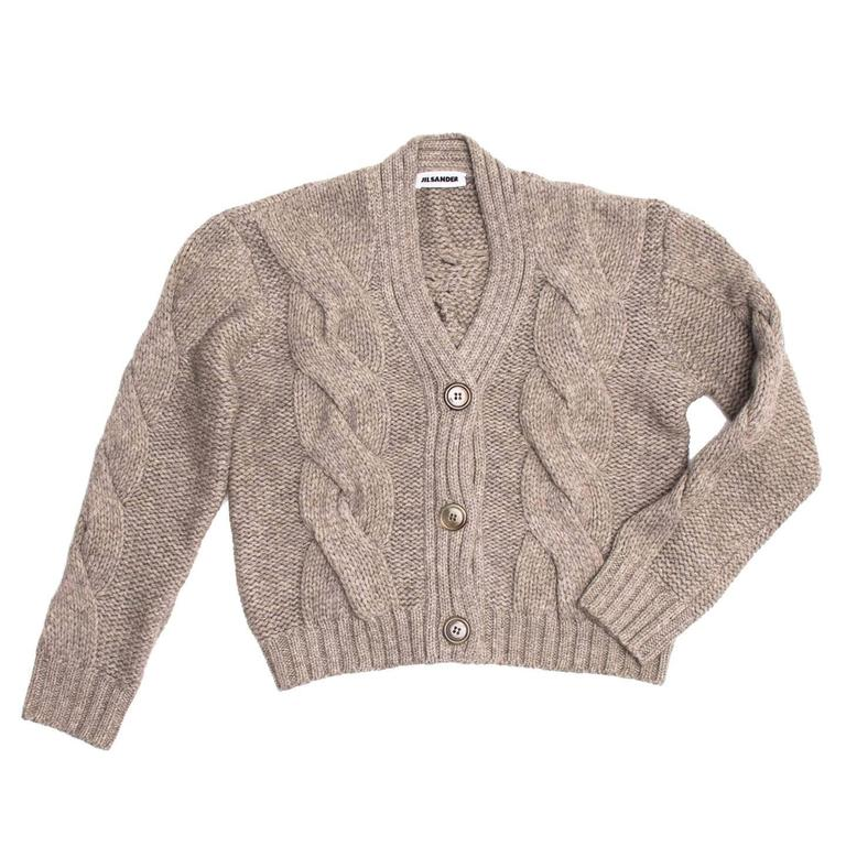Heather grey/taupe cable knit cropped cardigan with 3/4 sleeves.  Size  38 French sizing  Condition  Excellent: worn a few times