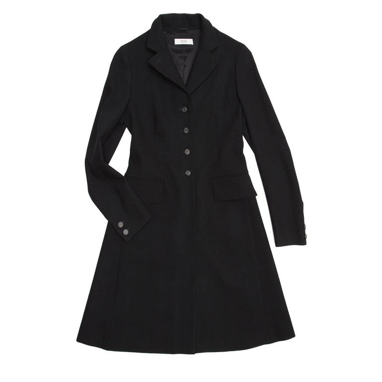 Black wool english riding vintage style coat, single breasted with small notched collar and front flap pockets. The fit is tight at top part and sleeves, while it is wider at skirt part.  Size  44 Italian sizing  Condition  Excellent: worn once