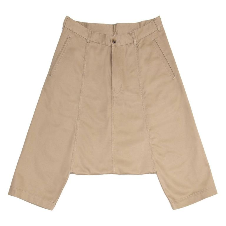 Khaki cotton harem style below knee pants with very low crotch to above knees. The front pockets are classic slit style while at the back the patch pockets are round and wide. All the seams are enriched by tone-on-tone top stitches as well as the
