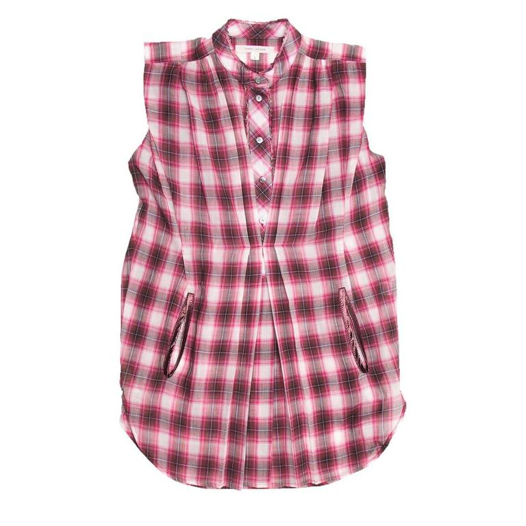 Red, black, grey and white plaid cotton sleeveless long shirt with raw edge inserts on Nehru collar and button placket. Round shaped hem with detailed side vents and front pockets enriched with satin profiles. Light pleats at front and little