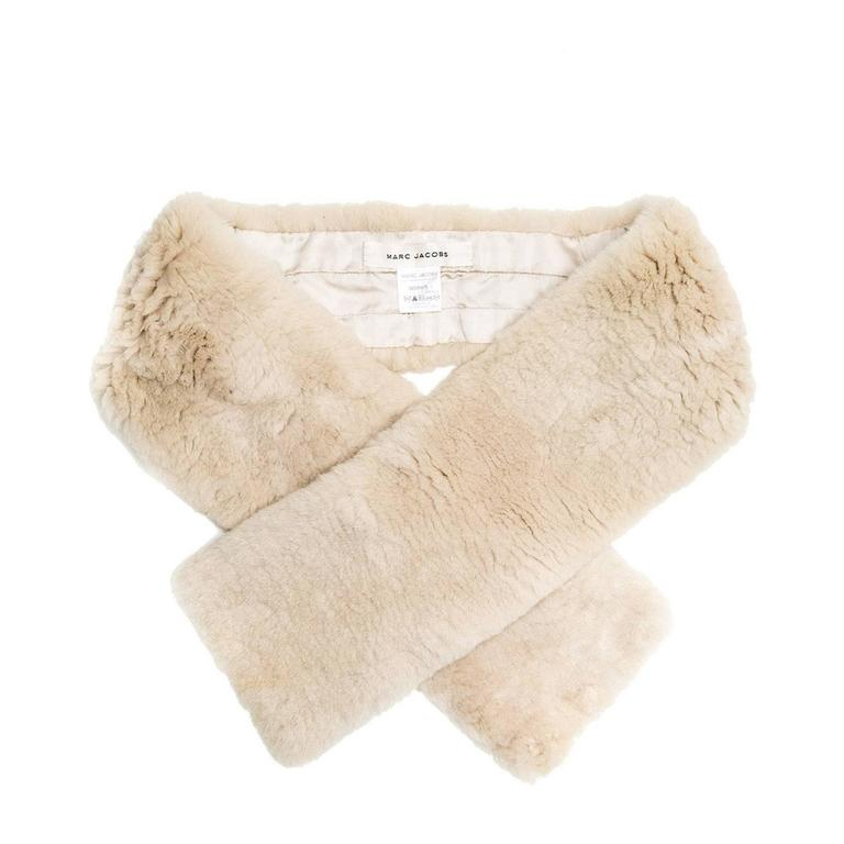 Natural color shearling fur scarf with tone on tone matching satin lining and the closure detail is made with a loop of satin.  Size  L 42