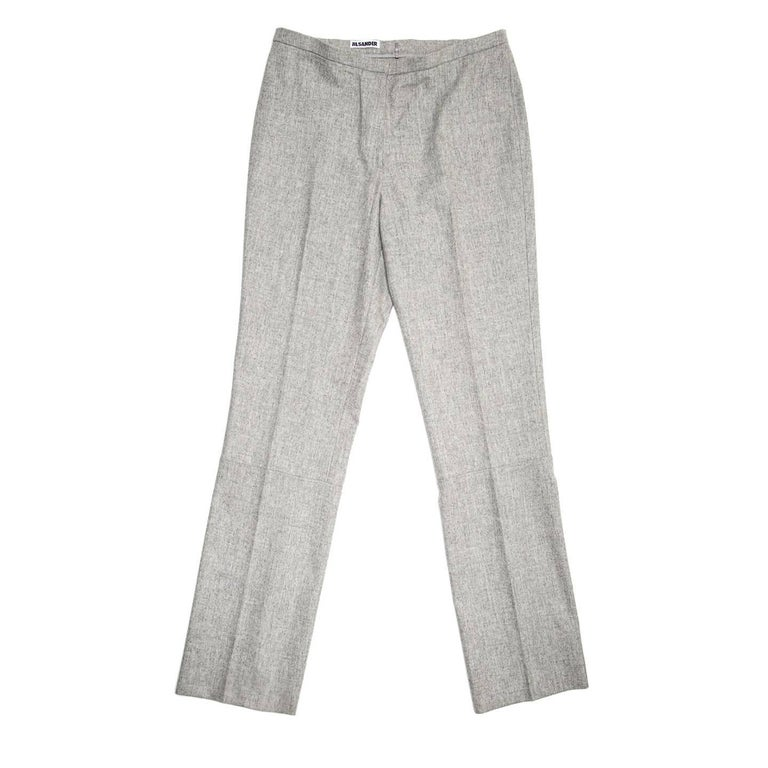 Light grey pure wool elegant pleated trousers with thin waistband, straight legs and seam detail at knee.  Size  42 French sizing  Condition  Excellent: worn a few times