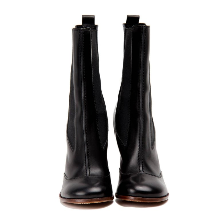Celine Phoebe Philo collection black leather closed-toe wooden heel boot with dual elastic panels at sides. Vero Cuoio. Made in Italy. Heel 4.75