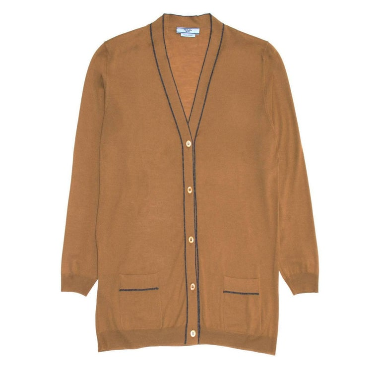 Prada caramel brown lightweight wool cardigan with V-neck and enriched by dark grey profiles around the neck, central front panels and pockets. The fit is straight and hip length. Made in Italy.  Size  46 Italian sizing  Condition  Excellent: never