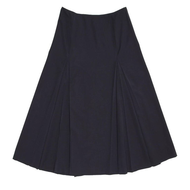 Prada Midnight blue calf length virgin wool skirt with two deep inverted pleats at front and two at back, which emphasize the A-line volume.  Size  46 Italian sizing  Condition  Good: worn a few times