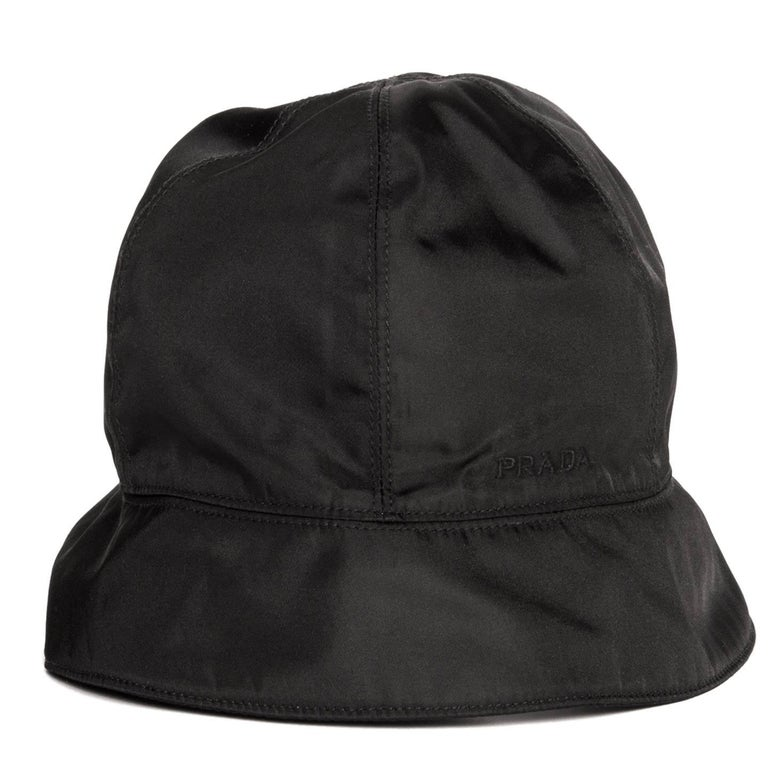 Prada Black nylon bucket cap divided in sections embellished with tone-on-tone top stitches, with a small brim and the Prada logo embroidered on the side.  Size  L Universal sizing  Condition  Excellent: never worn