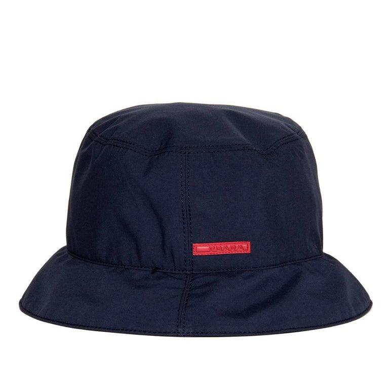 ff7da0dc590 Prada navy blue gore-tex bucket cap with tone-on-tone top stitching