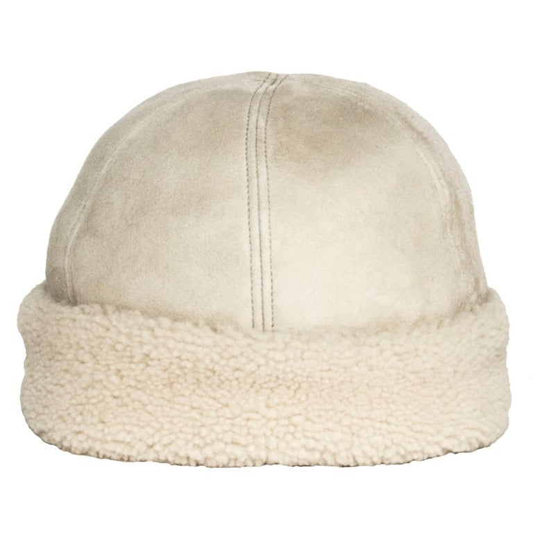 Prada ivory dyed sheep leather hat with suede exterior and shearling interior and turn-up.  Size  L Universal sizing  Condition  Excellent: never worn