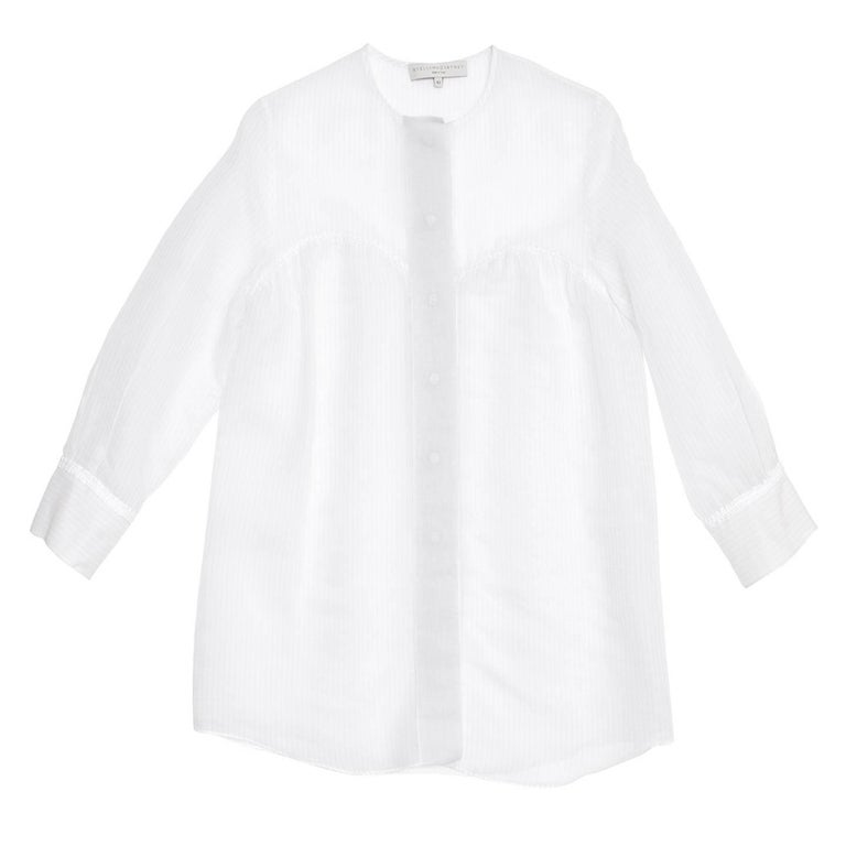 Stella McCartney silk & cotton blend sheer shirt with round neck, 3/4 sleeves and a soft volume. The front design has a hart shape yoke and from this line the sheer fabric has two layers. The main fabric of the shirt is ivory with thin grey stripes