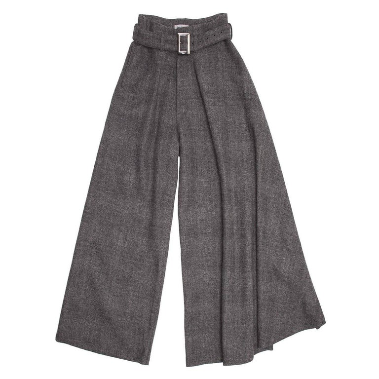 Yohji Yamamoto grey heathered wool palazzo pants with self buckled belt. Slit pockets at front side. Width of wearer's left leg is wider and drapes over front. High waisted with 2 pleats at front and a fly zipper opening.  Size  3   Condition