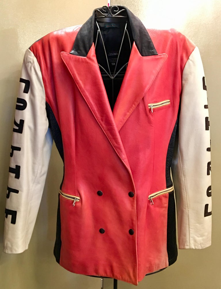"""Vintage Jean Paul Gaultier leather jacket coat is from the """"Russian Constructivist"""" Collection, Autumn-Winter 1986.  Fantastically styled Jean Paul Gaultier double breasted, all-leather jacket from the 1980s features bold contrasting ombre color"""